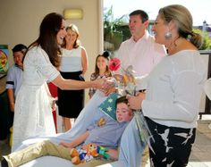 Duchess of Cambridge talks with patients and their families during her visit to Bear Cottage.