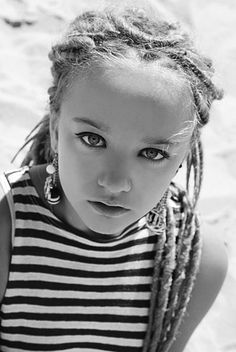 little baby with Dreads .... would never do it to my lil daughters beautiful hair but this little girl is cute with them i must say ...