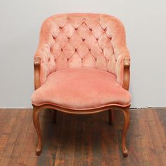 Eva blush chair: Peachy-pink velvet button-tufted ladies chair.