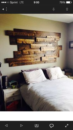 Awesome stained reclaimed wood headboard.
