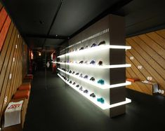 The use of light to focus the attention on products is key, sacrificing other light sources the shelving illuminates the entire space keeping the central wall at the centre of attention. The use of subtle sports references in the materials palette adds refinement to the store rather than 'in your face' sports branding.