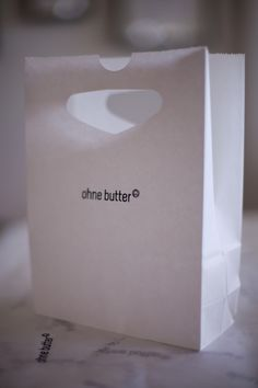 ´ohne butter´ paper bag Butter, Container, Logo, Logos, Logo Type, Butter Cheese, Canisters, Environmental Print