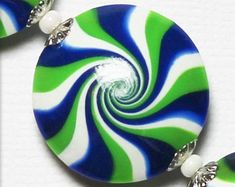 Check out our seahawk crafts selection for the very best in unique or custom, handmade pieces from our shops. Polymer Clay Beads, Handmade Polymer Clay, Etsy Crafts, Seattle Seahawks, Lentils, Jewelry Supplies, Spiral, Nfl, Lime