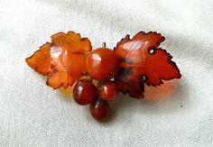 Cherry amber Bakelite Oak Leaf and Berry Pin