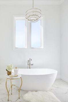 We are so excited to share our Ridgewood Estate project with everyone! This home sits on a beautiful piece of land nestled in the trees and complete with a pond. The master bathroom tub shown here is the perfect spot to wind down from a busy day.