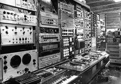 Karlheinz Stockhausen - vintage photo of professional recording music studio -note the keyboard in the foreground. RESEARCH - cSw http://www.pinterest.com/claxtonw/professional-recording-music-production/ - PROFESSIONAL RECORDING MUSIC PRODUCTION. Famous 20th century German composer composed 376 individually performable works. From 1977 to 2003, composed cycle of operas LICHT / LIGHT. Wall to wall technology from approximately the 1950s and 1960s, black & white photo.