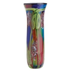 Like the magnificent feathers of a peacock's tail, a dazzling fusion of color and shape adds lustrous life to this regal glass vase. A theatrical centerpiece th