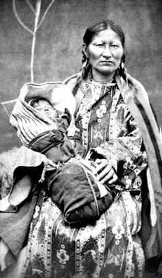 Spotted Tail's wife & baby. Brule Sioux. No date. No photographer.