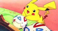 Pikachu tickling Togepi
