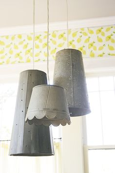 The bold wall covering provides inspiration for all the other design elements in the room. The fresh yellow hue gets a boost thanks to the hint of green on the leaves. Industrial looking light fixtures are an interesting contrast.