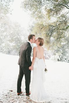 Sweet kisses in the snow | Photography: onelove photography - www.onelove-photo.com/  Read More: http://www.stylemepretty.com/california-weddings/2014/05/09/cozy-union-hill-inn-wedding/
