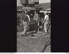 PORT MELBOURNE, VIC. 1946-02-21. JAPANESE SEAMEN AT WORK ON THE DECK OF THE KOEI (KOYEI) MARU. THE FORMER MINELAYER, STILL CREWED BY JAPANESE NAVAL PERSONNEL, HAD ARRIVED TO REPATRIATE 2800 ...