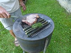 griller made from the drum of a washing machine or dryer.