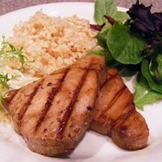 White wine, lemon juice, and soy sauce flavor this marinade for swordfish steaks cooked out on the grill.