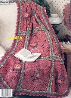 crochet blanket  pink flower green leaves white background