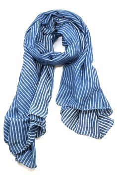 Bundle up in this beautiful blue striped scarf.