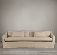I like the clean lines on this sofa. I like the single cushion and sloped lines.  I don't like the loose skirt on the bottom.