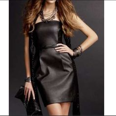 Express Strapless Tube Dress Timeless black dress with no signs of wear or tear. Has a slit in the back of the dress with 2 front pockets. Express Dresses Strapless
