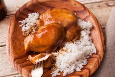 An easy Asian-style slow cooker chicken thigh recipe. The chicken cooks with tamari or soy sauce, ginger, brown sugar, cinnamon, orange, star anise, and sherry.