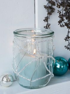 this is lovely - thinking fun spring colors with wire & citronella candels