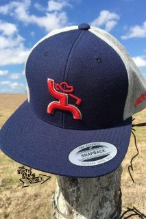 cb52c55efbe Navy and Grey Snapback Red HOOey Golf Man outlined in grey on the front Back  of the cap features grey fabric Navy adjustable snap One size fits most