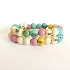 Colorful Acai Bead Bracelets / Natural Boho Bracelet / Eco Friendly Tribal Fashion / Pink Blue Yellow Green Spring Fashion / Earth Day Gift by theblackstarboutique on Etsy https://www.etsy.com/listing/261932028/colorful-acai-bead-bracelets-natural