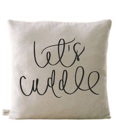 "An affordable and instant way to make their new home feel a whole lot cozier. This decorative throw pillow features the phrase ""let's cuddle"" in hand lettered calligraphy, and can be printed in your choice of 16 colors to suit their décor."
