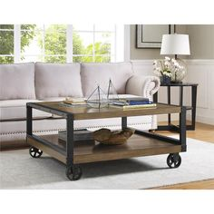 Wade 47.6 in. L x 47.6 in. W Wood Veneer Coffee Table with Rolling Casters in Rustic Gray