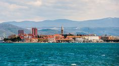 A well-established port-town, Koper boasts a lovely and compact medieval center, and serves as an excellent springboard for Slovenia's many attractions. Koper Slovenia, Julian Alps, Train Tour, Heart Of Europe, Lake Bled, Royal Caribbean Cruise, Get Outdoors, City Beach, Cruise Vacation