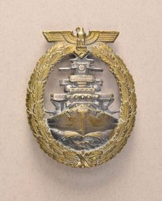 Germany (1933-1945) - High Seas Fleet Badge. Buntmetall silvered and gilded marked FEC. ADOLF BOCK AUSF. SCHWERIN.BERLIN open work.