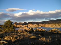 This photo is from my recent trip to Prescott AZ.  This shot is of Watson Lake at sunset.  The sky was just clearing after a day of snow and hail showers, and it was quite chilly out.