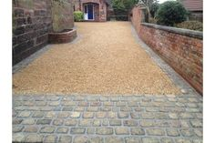 Gravel driveway with stone apron and edge.