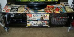 Decorated our entertainment center with mod podge and vintage magazines