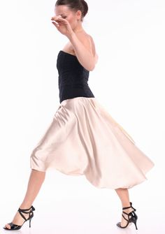 Anna Pridanova (in Riga, Latvia) makes pieces for the FunTango Etsy shop. Anna posts photos with movement, so you can tell how the dress might behave while dancing.    (sold) Pearl satin skirt for tango