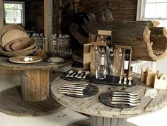 In the Eco Room, sustainable wares are displayed atop vintage cable spool tables. Diy Cable Spool Table, Wire Spool Tables, Large Wooden Spools, Wooden Cable Spools, Wine Cork Table, Spool Chair, Cable Reel, Cable Drum, Cheap Adirondack Chairs