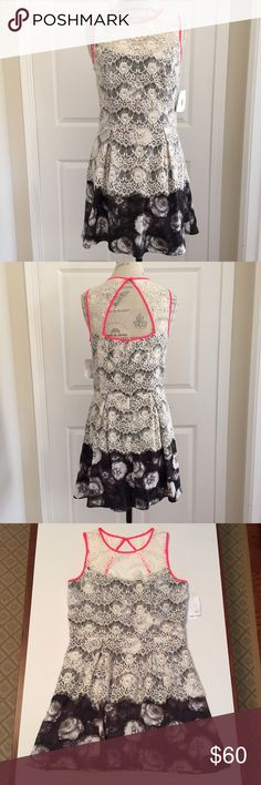 Dress by Jessica Simpson Size 10 Jessica Simpson Ivory and Black Lace Dress Sleeveless with High Waist Hidden Back Zipper Cutout Back Pleated Front and Back with Black and Ivory Floral Print on Bottom Lined Size 10 100% Polyester 65% Cotton 35% Polyamide Lining is 96% Polyester 4% Elastane Real Cute! NWT Jessica Simpson Dresses