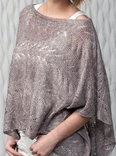 Free Knitting Pattern for Katia Poncho - Lace poncho knit in two pieces. Available in English, Spanish, French, and Dutch.