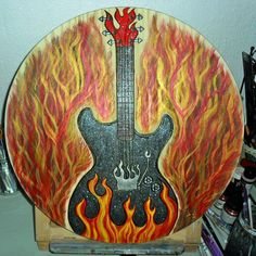 #🎸 still working on it! Need to do the strings and work on the flames some more😎 #guitarist #musiclife #🔥🎸 #rocknroll #burntwood #GuitarPlayer #🎼🎶🎵 #guitarlover #guitarstudio #musician #guitarpyrography #woodworking #customguitars #guitarcovers #tcavanwoodworks  #sparkle #whammybar #guitarstrings #riff #band #🔥flames #sparkleguitar #art🎨 #rockstarguitar #Guitar #electricguitar #musicart #passion