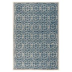 Featuring a bold medallion design in blue and ivory hues, this hand-tufted wool rug is perfect for adding interest to neutral carpets or bare wood floors.   ...
