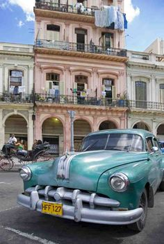 old american car parked in street in havana-cuba Cuba Today, Cuban Cars, Old American Cars, Pontiac Cars, Exotic Places, Havana Cuba, Central America, Car Parking, Vintage Cars