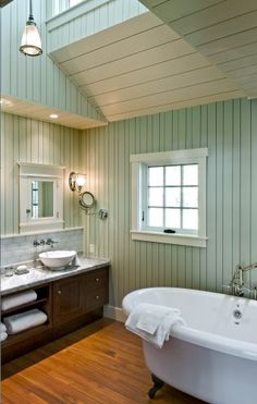 Love this bathroom ...... the paint color, the wood paneling, and the bathtub!! Looks warm & inviting for a long, hot soak!!