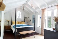 black, white, neutral and blue bedroom A Small Silver Lake Bungalow That's a Little Bit Rock & Roll