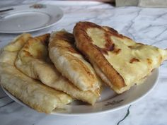 This is khatchapuri. It is bread and melted cheese and it is out of this world. | 25 Reasons You Should Visit The Country Of Georgia Right Now
