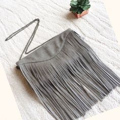 2X HP Fringe envelope clutch Poshmark's retail launch party host pick!                     Beautiful gray vegan leather fringe clutch with removable chain, hidden magnetic closure, inside zip pocket. No trades. No offers, price is firm unless bundled. Boutique Bags Shoulder Bags
