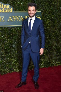 British star: Dominic Cooper chose a shiny navy blue suit with a matching tie and a contrasting white shirt and his trademark spiky hair gelled up to perfection