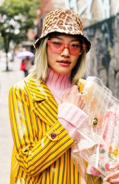 Inside the Webster Buyer Gia Seo's Closet: Yellow Striped Jacket, Pink Turtle Neck, Pink Sunglasses, Leopard Print Hat | coveteur.com