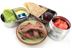 Lunch box ideas: steak tacos with sour cream, cheese, guacamole, watermelon, plum and whole wheat tortillas