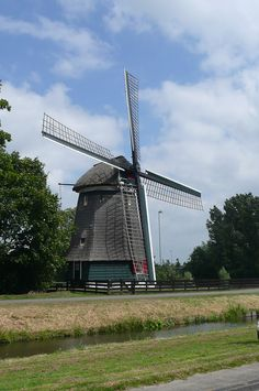 Windmill and polder, the Netherlands. Netherlands Windmills, Holland Windmills, Throughout The World, Around The Worlds, Amsterdam, Water Tower, Le Moulin, Travel Memories, Covered Bridges