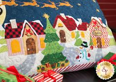 """**Shipping Mid-November** Designed by and exclusively available from Shabby Fabrics, The Christmas Eve Series Pillow will bring all the magic and whimsy of Christmas to your home! To coordinate your entire home, you can also make the Christmas Eve Series Wall Hanging and Table Runner. This Pillow is BIG and measures approximately 21"""" x 40"""". Kit includes:   Pattern  All top fabrics including BACKING Specialty buttons and embellishments  Products used:  10pc Christmas Eve Thread Set (..."""