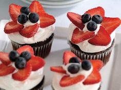 Perfect cupcakes for the 4th -- stars made from strawberries and blueberries.
